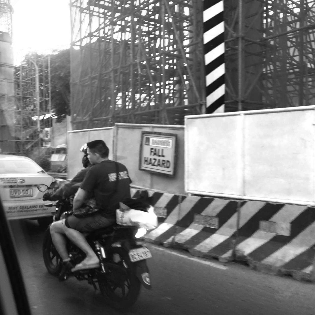 manilla man on bike no helmet