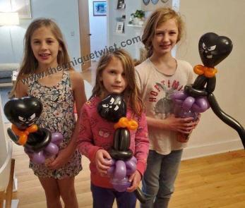three_girls_black_cats