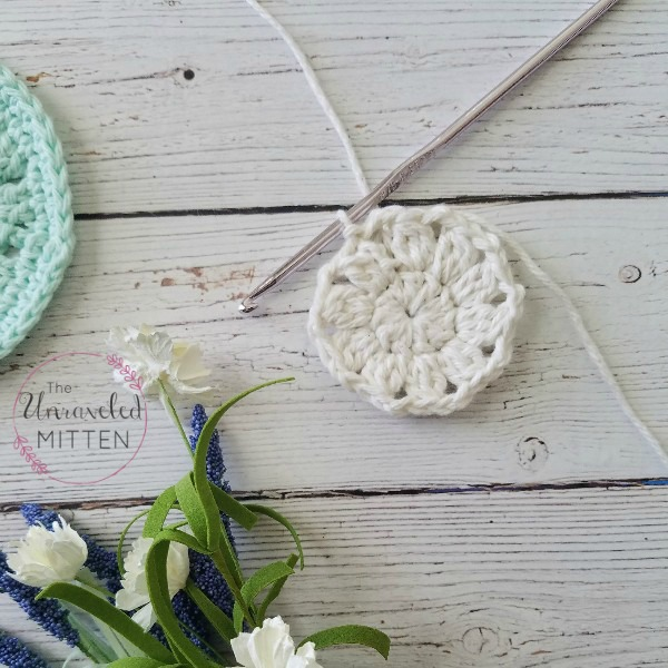 Spring Blooms Crochet Coaster progress after round 2