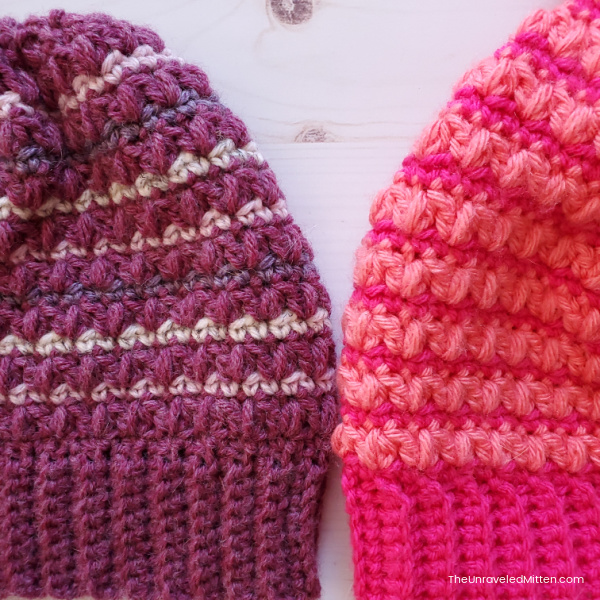Two striped crochet hats next to each other.