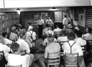 16-G-130-S-24069-C: Wooster, Ohio. Selling eggs at auction. August, 1938