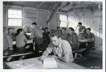 """35-GE-1G-34-524 """"34-524 CCC 1938 Spelling exercises serve in place of setting up exervise (sic) for these members of Co. 544, CCC, Yellowstone Park in Fort Missoula District, CCC, Montana."""""""