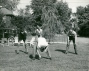 Original Caption: The family life of a truck driver is similar to other workers. Mr. Earl L. Marcey of Arlington, Virginia takes time to play football with his three sons, September, 1948. Local ID: 306-PS-514-S-48-620