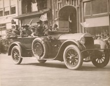 Wounded men of the 369th ride during the Harlem Parade. Local Identifier, 165-WW-127-35.