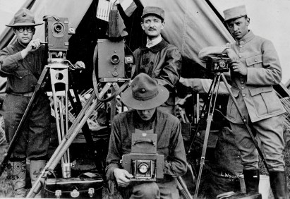 This photo, from the Signal Corps series, shows a combined unit of American and French cameramen. The man on the left is a motion picture cameraman for the U.S. Marine Corps, and the man in front is a still photographer and U.S. Marine. (111-SC-4373)