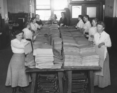 """Blind women putting pages together before binding them into magazines or books, which are printed for blind soldiers. The soldiers read by feeling the shape of the letters."" Date taken: July 26, 1918 (Local ID: 165-WW-32A-4)"