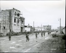 "111-SC-186263 ""Parachute regiment, Headquarters company, entering the city of Naples, Italy. 505th Parachute Regt., Hdqrts. Co."" October 2, 1943"