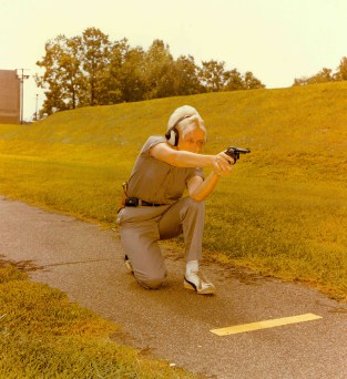 """The kneeling position of the practical pistol course, FBI Academy, Quantico, VA."" Date Taken: February 1976 (Local ID: 65-QT-9-8)"