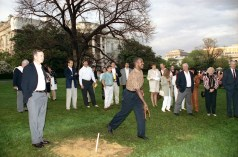 """(Local Identifier: P30990-25) """"President Bush Pitches Horseshoes with Players at the Redskins Barbecue at the White House"""". George H. W. Bush Presidential Library"""