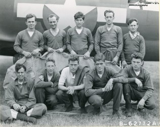 "342-FH-3A ""Lt. Lockhart and crew of the 401st Bomb Squadron, 91st Bomb Group, 8th Air Force beside a B-17 Flying Fortress. England, 18 August 1943."""