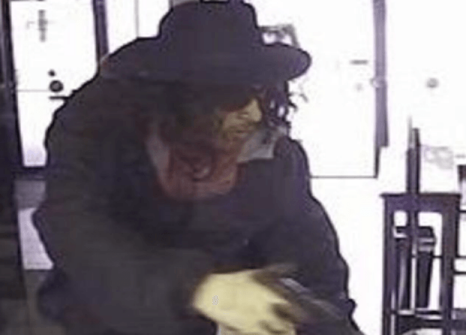 The second suspect is seen here with Super Fly hair and hat.
