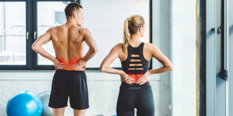 athletic man and woman experiencing back pain