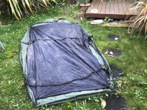 Tent pegged out on the garden lawn with the groundsheet facing upwards