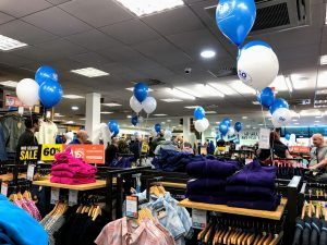 Balloons above the jacket racks to celebrate the opening of Go Outdoors Preston