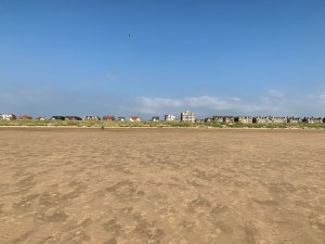 Looking across the sand towards the mansions looking tiny at lytham st annes beach