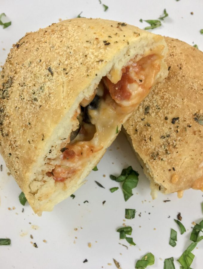 Dairy-Free Pizza Pockets fresh out of the oven are a guaranteed crowd-pleaser. Nothing screams nostalgia quite like pizza pockets! Recreate a healthier and homemade version using puffy dough, dairy-free cheese, your favorite marinara, and toppings.