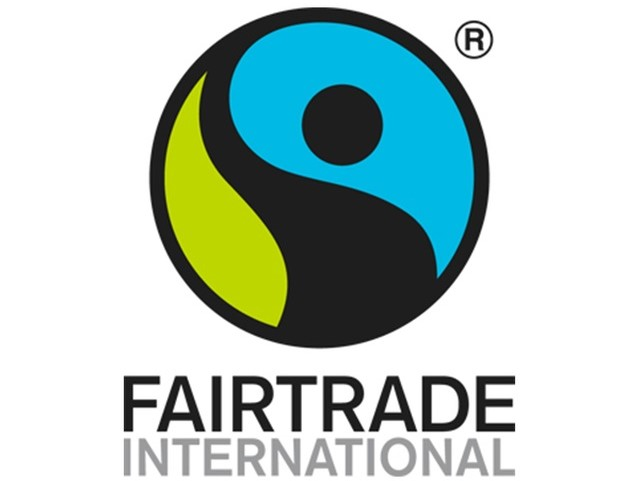 FairTrade International Logo. A circle outlined in black with a green, blue, and black shape inside it.