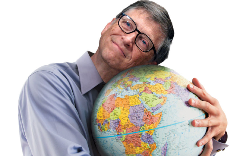 Bill Gates smiling and hugging a globe.