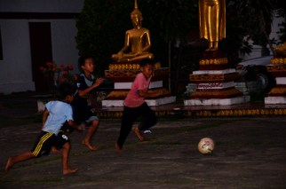 Soccer in the Wat Mai grounds