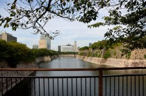 View across moat to modern city.