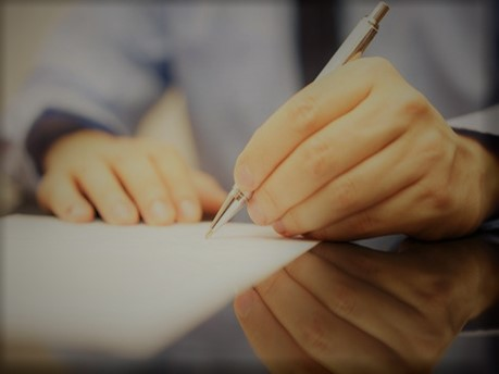image of a man writing a letter of complaint and reject to a car dealership in the UK