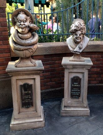 """Orlando - Disney World - Magic Kingdom - Haunted Mansion - Queue - Bertie & Aunt Florence Gravestones"" by jared422_80 is licensed under CC BY"