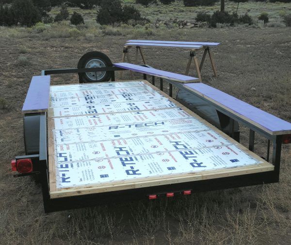 The trailer bed, seen from behind. All the insulation is installed but only some of it is taped down.