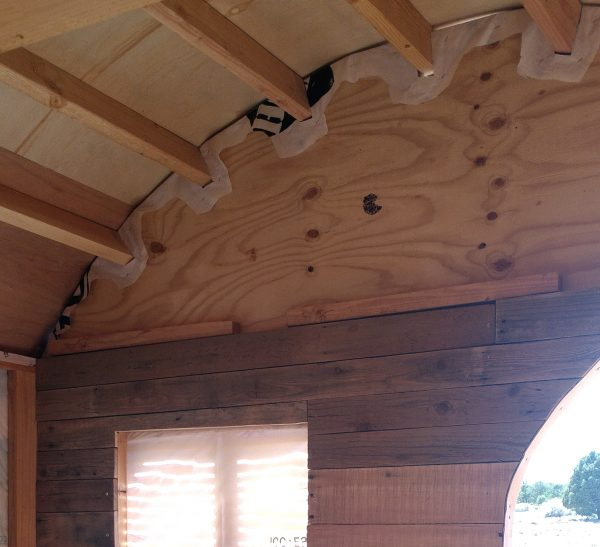 It's done up to the arched part of the wall, & then it's not actually done at all. Look! Plywood!