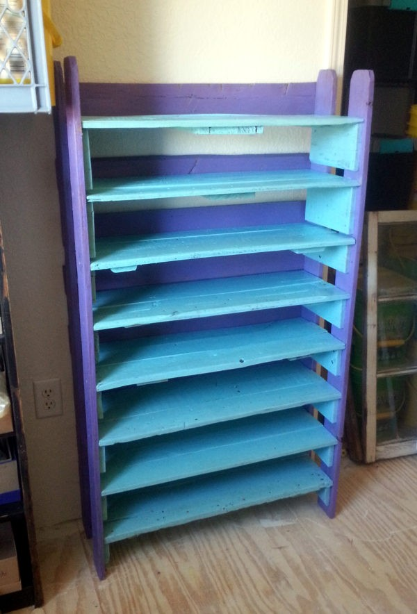 The same shelves, now up against a wall! The vertical parts are a deep purple & the horizontal bits are a nice ocean blue.