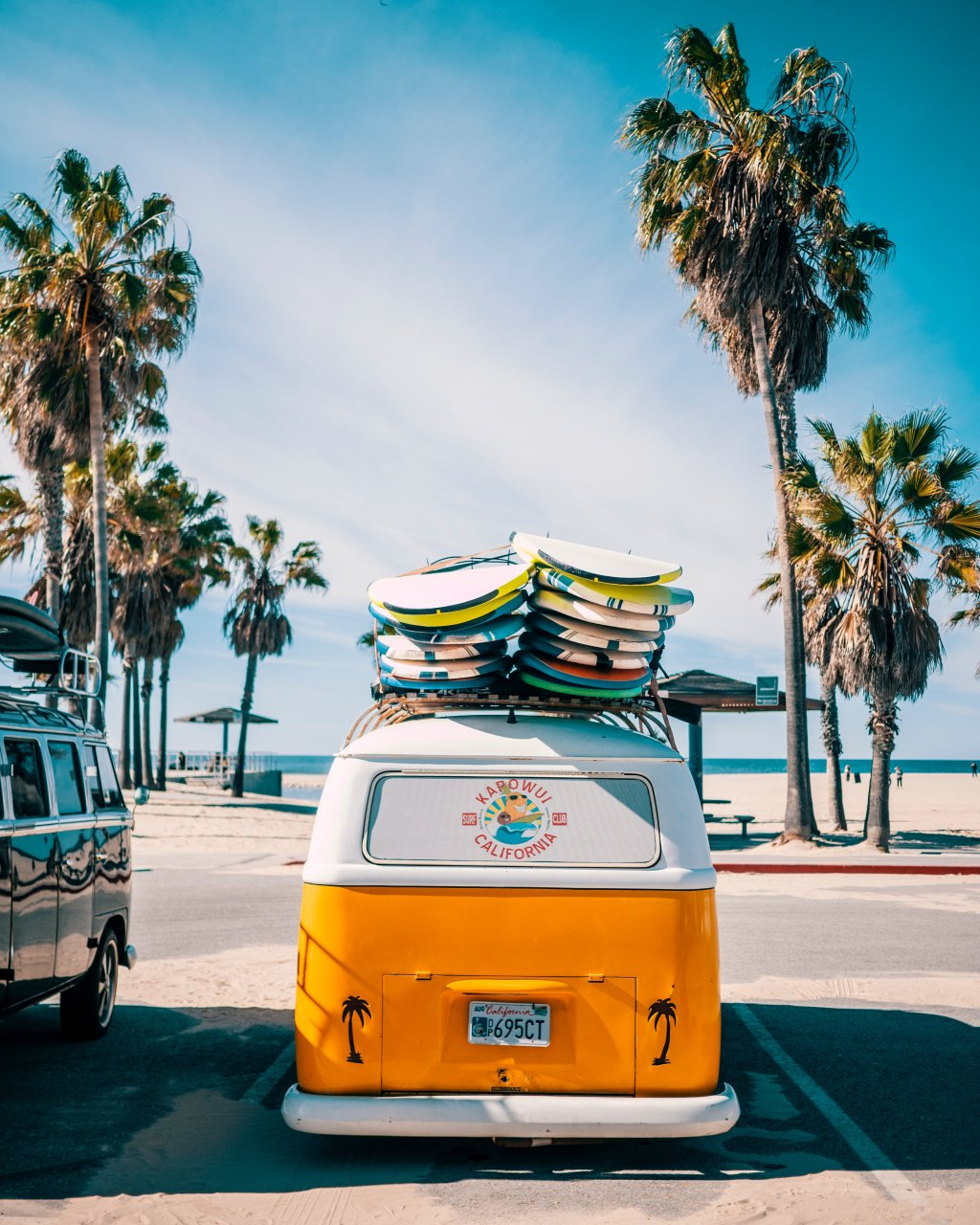 Van with surfboards parked in Venice Beach, Los Angeles, California.
