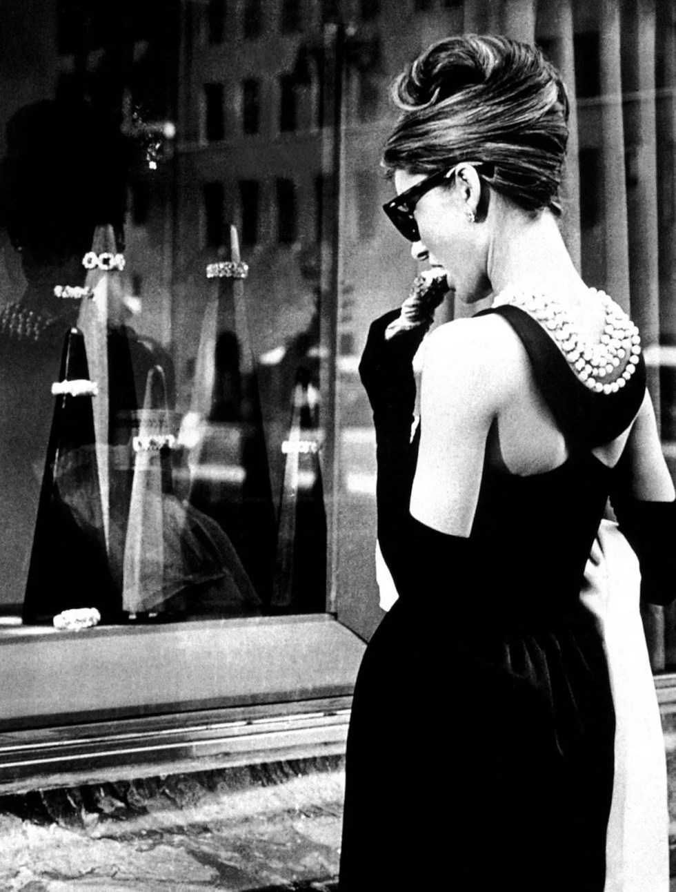 Hepburn's portrayal of Holly Golightly wearing Givenchy in Breakfast at Tiffany's movie.