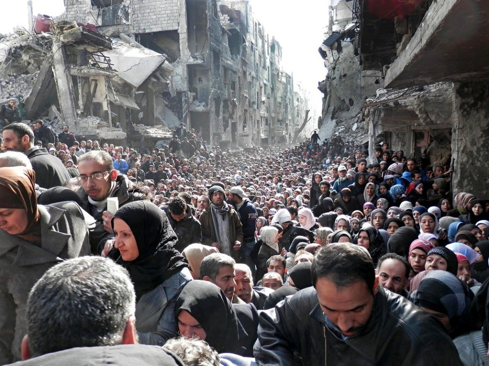 The 2014 photo of Syrian people lining up for food than went viral online.