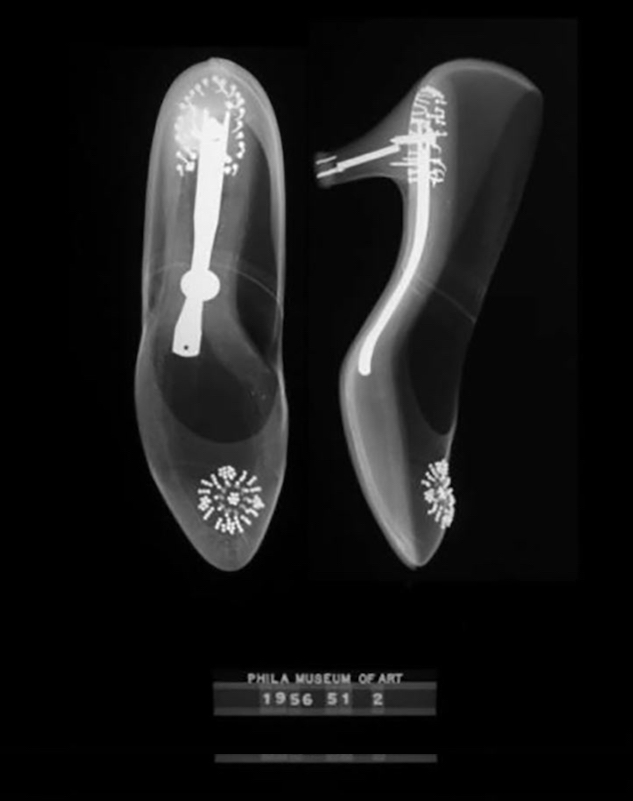 X-rays of Grace Kelly's wedding heels. A copper penny can be seen embedded inside one of the heels.