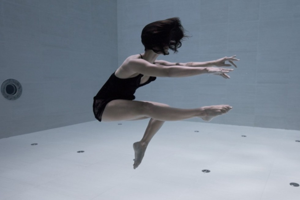 Artist Julie Gautier carrying out a stunningly beautiful underwater choreographygliding through the crystal-clear water of the world's deepest pool.