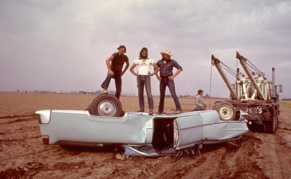 """Chip Lord, Doug Michels, andHudson Marquez from art collective """"Ant Farm"""" while working on the Cadillac Ranch project."""