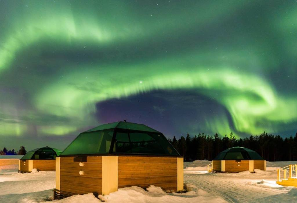 Three of the 39 glass igloos of the Arctic SnowHotel & Glass Igloos in Finland where you can spot the legendary Northern Lights.