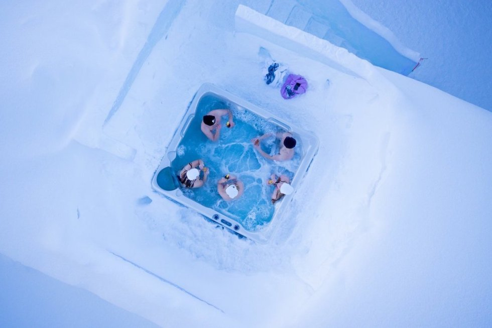 The outdoor jacuzzi of Arctic SnowHotel & Glass Igloos in Sinettä, Finland.