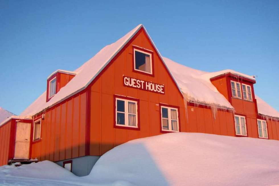 Ittoqqortoormiit Guesthouse in Greenland offers off-grid stays surrounded by arctic wilderness.