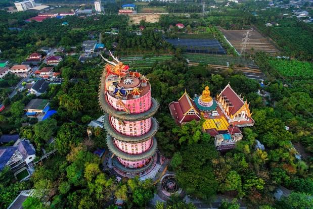 The towering pink masterpiece of Wat Samphran Dragon Temple in Thailand.