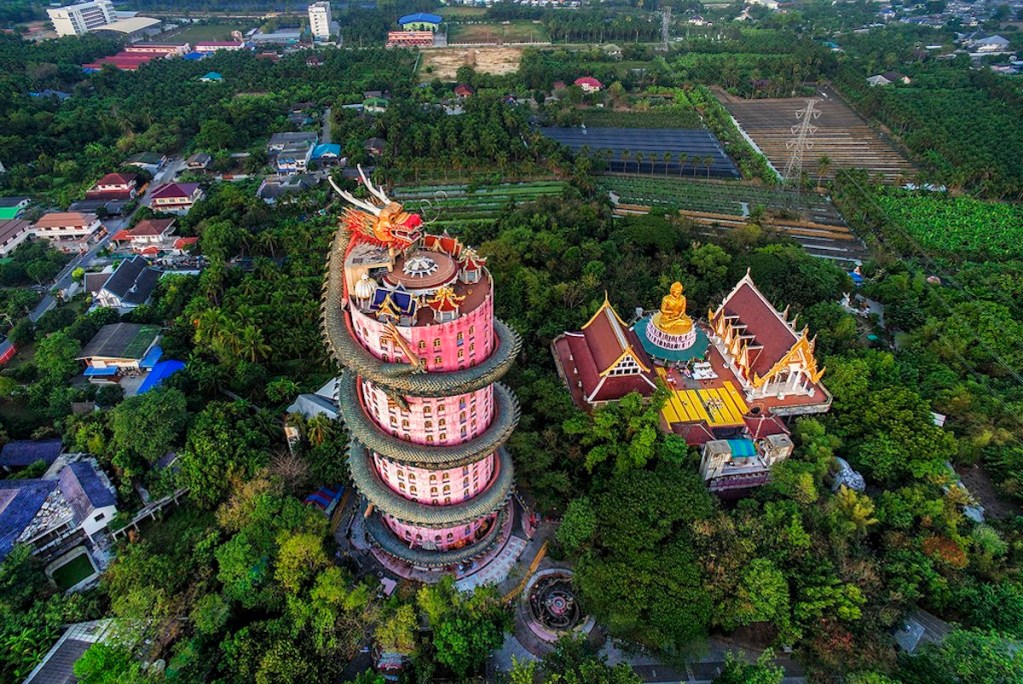 The towering pink masterpiece of Wat Samphran Dragon Temple in Thailand.