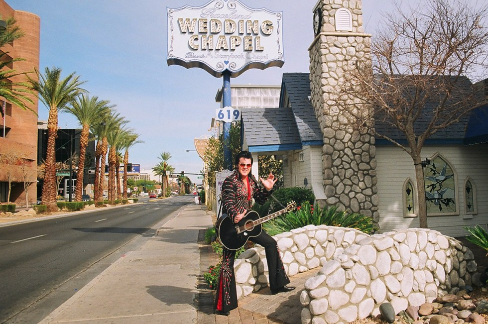 A man dressed as Elvis Presley outside the Graceland Wedding Chapel in Las Vegas, Nevada.