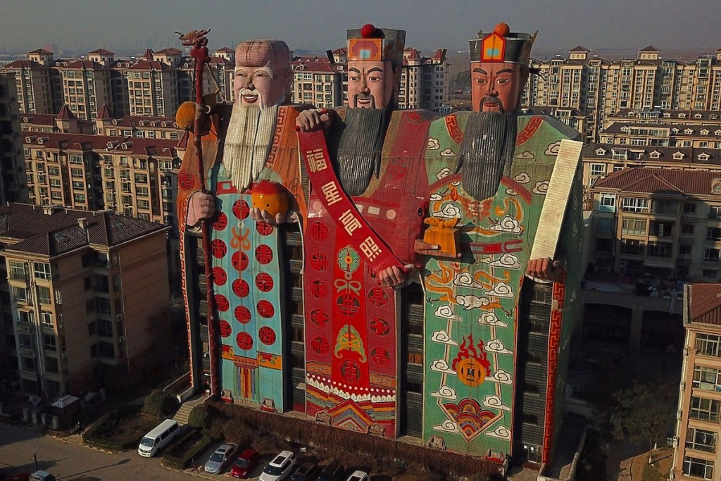 Giant images of Chinese deities decorating the Tianzi Hotel In China's Hebei province.