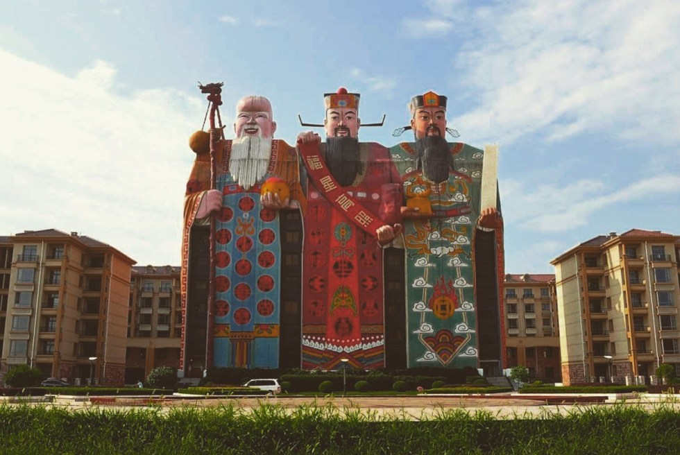 """Located in Langfang, Hebei province, China, the trio of ancient Chinese deities of Tianzi Hotel represents """"the good life."""""""