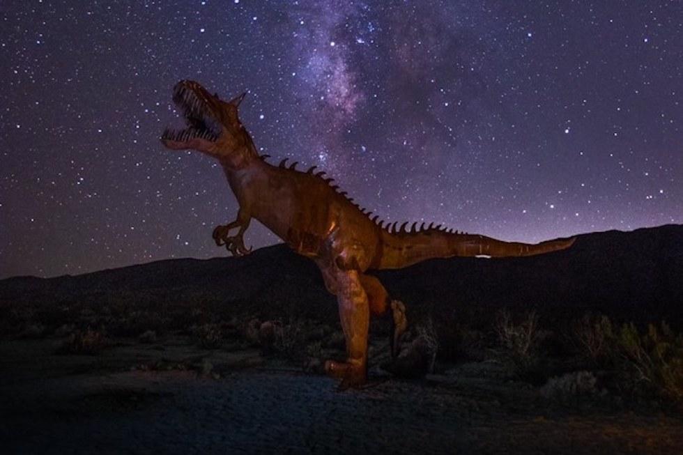 The Galleta Meadows Estate dinosaur sculpture at night.