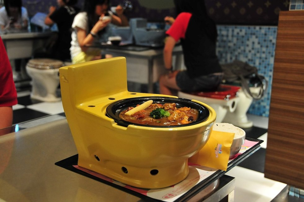 Food served in a toilet bowl in Modern Toilet Restaurant.