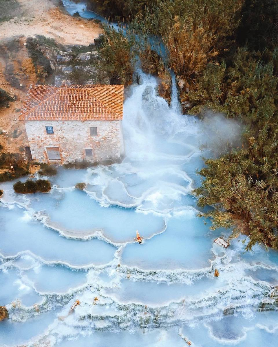 Aerial photo of Cascate del Mulino hot springs in Saturnia, Italy.