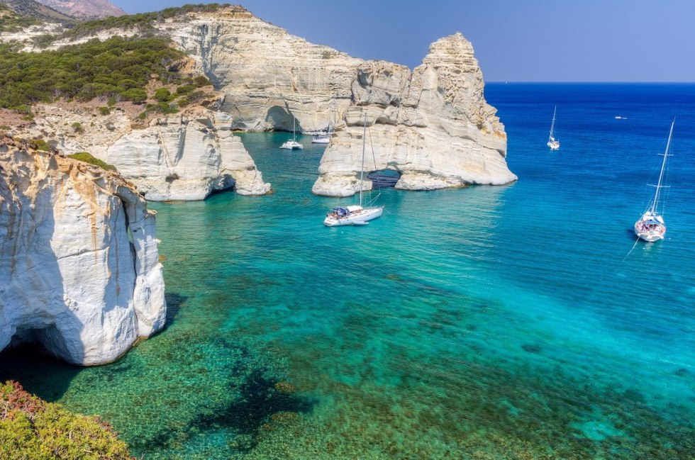 A cluster of volcanic white rocks in the turquoise waters of Kleftiko in Milos, Greece.