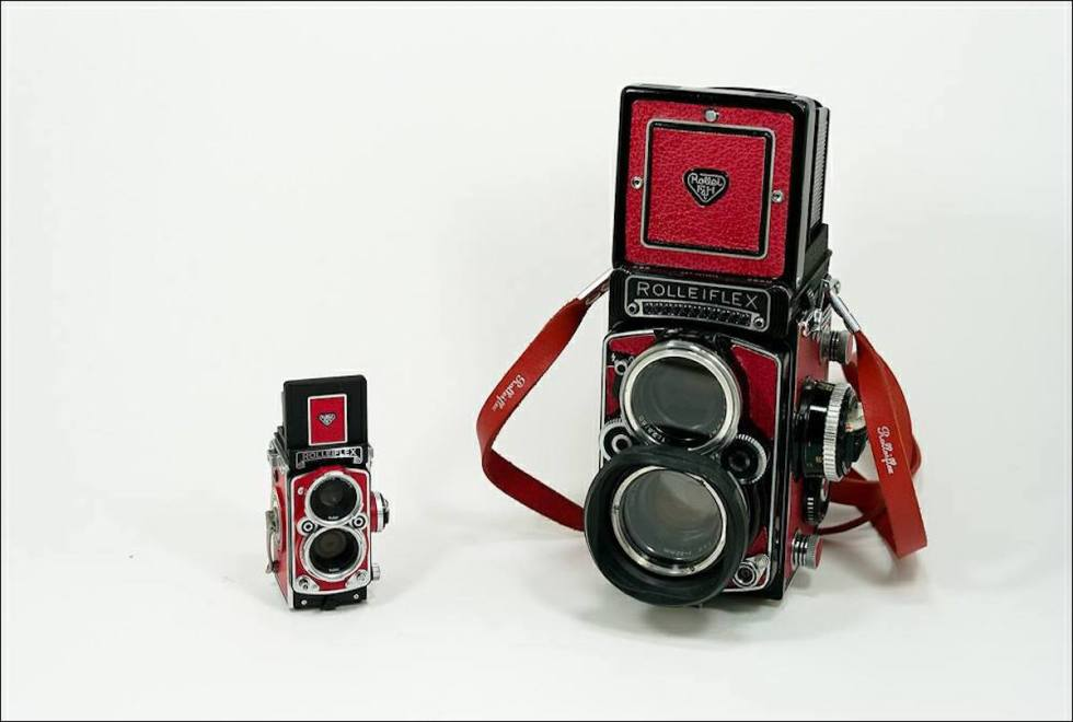 Two red Rolleiflex 2.8 F cameras.