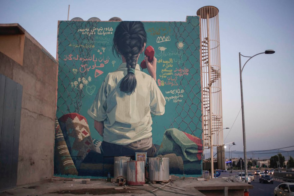 "Large-scale mural in Slemani, Iraq, created for the ""Opening Lines"" project by street artist Pat Perry."