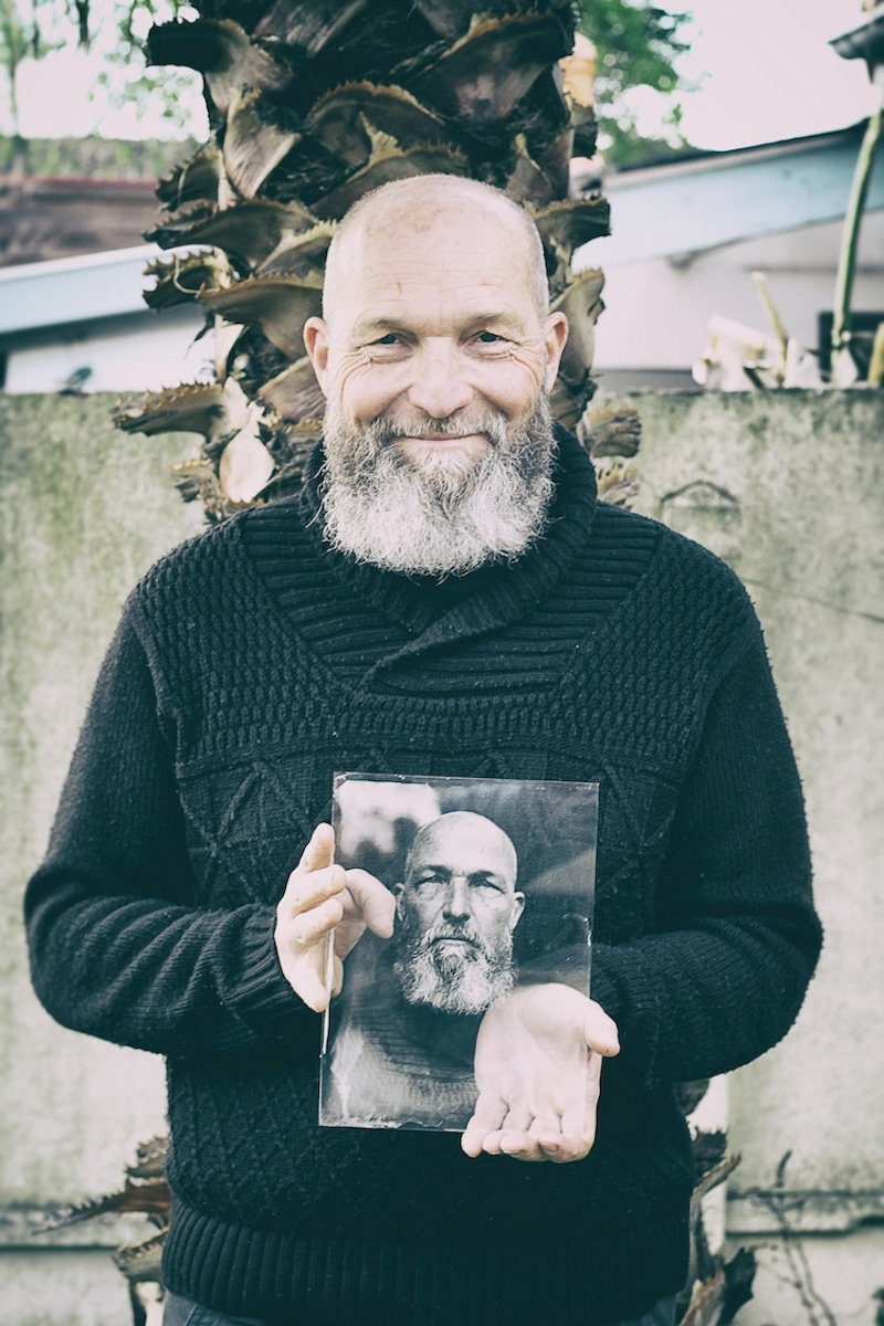 Man and his portrait, taken by wet plate photographer Michaël Tirat.